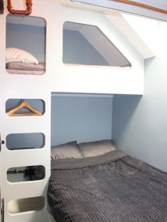 Double bed with kid sized single bed over (170cm long)