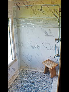 Custom 5' x 5' marble, glass and stone tiled shower with a seaside view, ensuite of Master Bedroom
