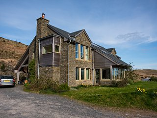 Beautiful Eco House with spectacular views over Carsfad Loch and Rhinns of Kells