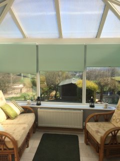 The conservatory has outstanding views over the Worth Valley