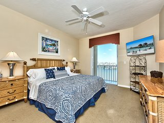 Master Bedroom with King Bed and Flat Screen TV; Private Entrance to Balcony Area; Freshly Decorated!