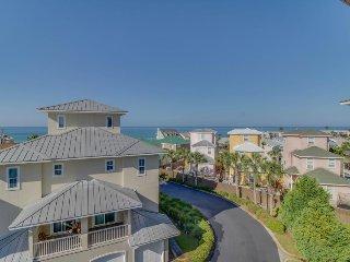 Four-story duplex w/ private elevator, shared pool & convenient beach access!