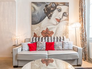 Marais apartment full of natural light with original painting by Pascal Amb