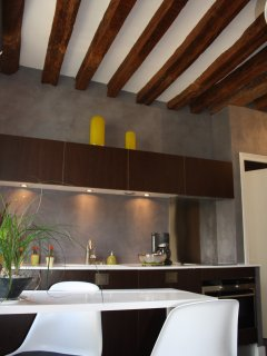 Authentic wooden ceiling beams throughout the apartment