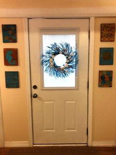 A seashell wreath welcomes you inside.
