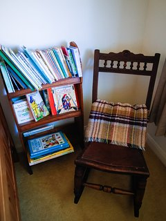 Children's books in a quiet corner.