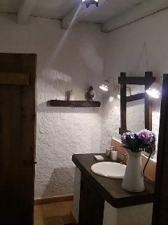 Well maintained bathroom with spa shower in corner.