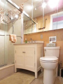 Earthy Bathroom Two: featuring roomy shower and ample medicine cabinet storage