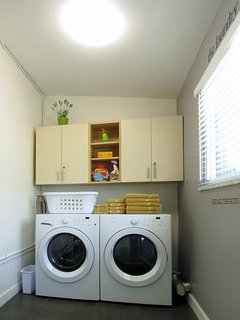 Laundry Room features new Frigidaire large-capacity, front-loading machines