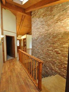 Hallway & stairway to downstairs bonus room + bedroom, Unit 5 Lot 133, dog friendly Pine Mountain Lake vacation rental...