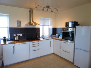 The kitchen is well equipped and includes a dishwasher and nespresso machine