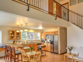 An open-concept layout and high ceilings create a spacious feel throughout.