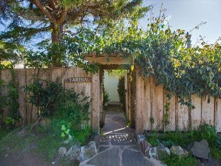 7 Arenal Ave is a cozy two bedroom, one bath cottage with beautiful garden.