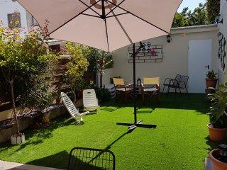 Apartamento 2minutos de la playa,wifi  Barbacoa, jardín privado 3 habitaciones.