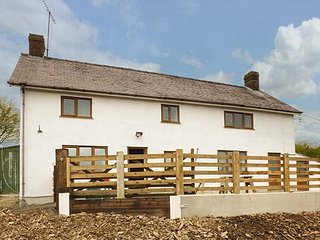 UPPER CAERFAELOG, detached farmhouse, hot tub, sauna, outdoor TV, WiFi, near