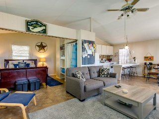 Cheery, dog-friendly home with a large deck, one block from the beach!