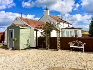 WOLD COTTAGE, detached, immaculately presented, woodburning stove, enclosed