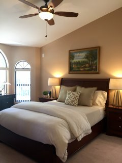 Spacious guest bedroom; large desk and beautiful hillside views