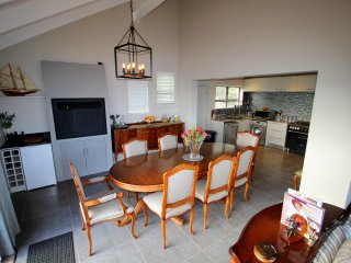 View of dining room and open plan kitchen area
