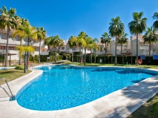 Beautiful beachside townhouse in gated complex with swimming pool