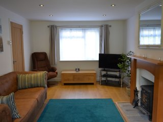 Spacious Living room with wood burning stove, smart TV, and bluray / DVD player & HDD recorder.
