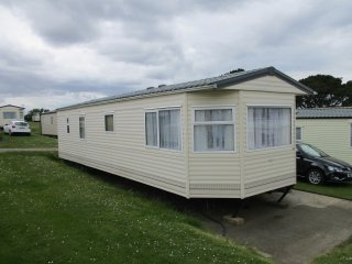 Rain or shine it's caravan time  at Sandhills,  Bembridge, Isle of Wight.