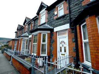 This substantial Victorian terraced property is within walking distance of town facilities