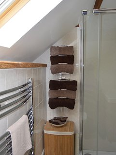 Heated towel rail and soft, fluffy towels