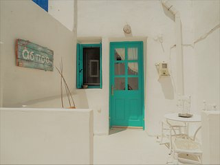 Aspro residence,traditional stone built home at the entrace of chora, Serifos