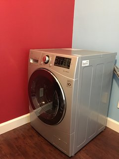 Front load washer/dryer with vent-less condensing drying system