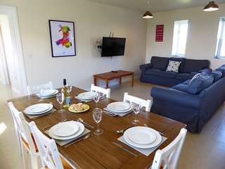 The living area has large comfortable sofas and a flat screen TV with freeview.