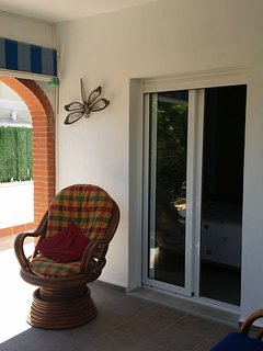 Patio doors from the front bedroom goes directly out onto the covered  front terrace