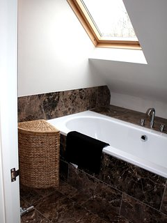 First floor ensuite to master bedroom - with shower, and bath.