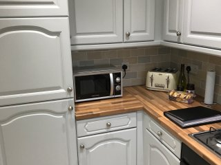 Fully functional kitchen with fridge freezer, gas hob, electric oven, dishwasher and washer/dryer