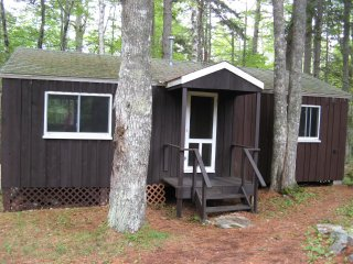 Private waterfront home and cabins with trails, dock, kayaks