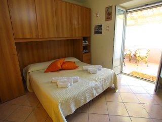 Stanza da letto con balcone vista mare, aria condizionata autonoma, wifi