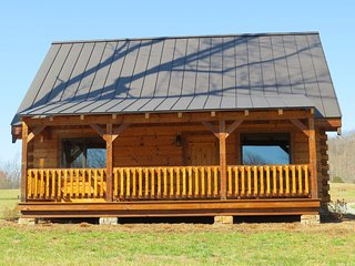 Amazing log cabin on 200 acres overlooking private