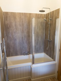 The  power shower over the full size bath, so you can either have a quick shower or a long soak.