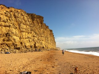 West Bay beach 8 minutes walk. Very sunny aspect. Great views. Safe. Welcoming.