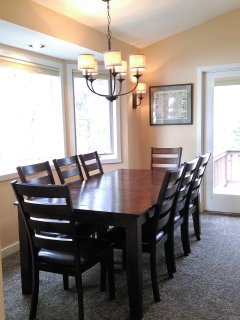 New select dining room set sits 8 with mountain  views.