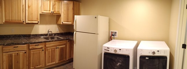 Lower level kitchenette with full laundry