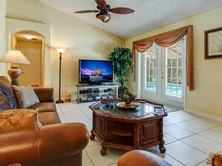 The family room, looking out onto the pool deck. With a 55' HDTV Netflix, HBO, Showtime and sports.