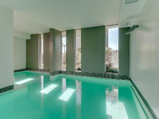 Cozy upper-level condo with shared pool & sauna near Dunes of Concón!