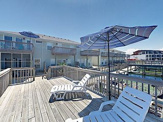 Waterside Condo w/ Private Boat Dock & Sunbathing Deck - Walk to Beach