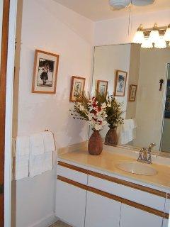 Fresh paint. a new overhead fan and vintage Hawaiiana photos grace the bathroom!