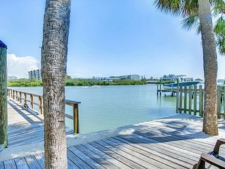 Watch Dolphins from the Patio! Charming 2BR Cottage w/ Dock—Walk to Dining