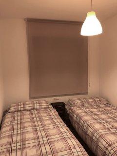 habitacion secundaria con dos camas