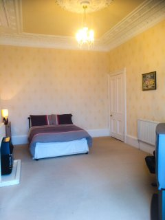 Spacious master bedroom with lovely sea views