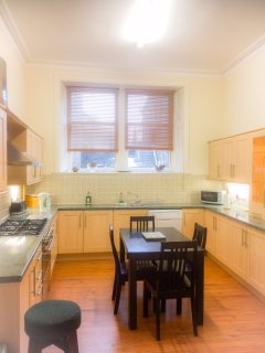 Fully equipped kitchen with gas cooker, dishwasher, fridge freezer and connecting utility room