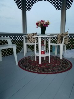 Inside the beautiful screened-in gazebo right on the water, with spectacular views from all angles.